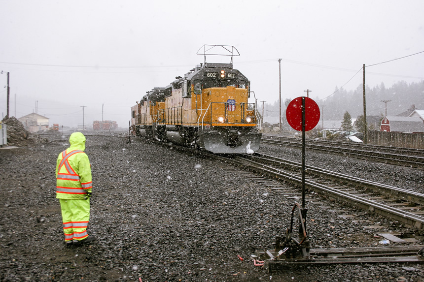 conductor stands by a Union Pacific flanger