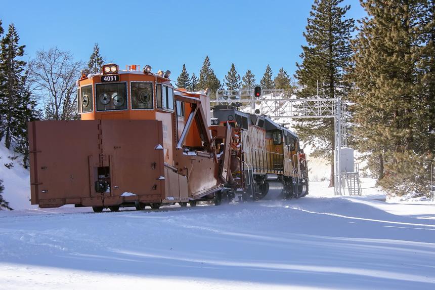 A Union Pacific spreader consist rolls through Yuba Pass