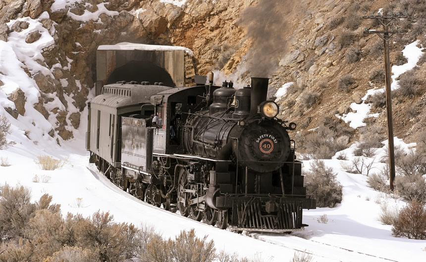 Nevada Northern Railway Locomotive No. 40 leads a passenger train out of the railroad tunnel