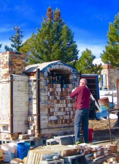 Master potter Ben Parks opening his kiln in Tuscarora.