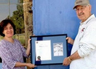 "Bill Dell presents a copy of the letter proclaiming his grandfather ""Wheezer"" Dell a member of the Pacific Coast League Hall of Fame to Gail Rappa, at Society Hall in Tuscarora."