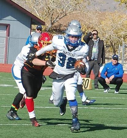 Star running back Christian Higbee gets through the line in the championship game against Whittell in 2015