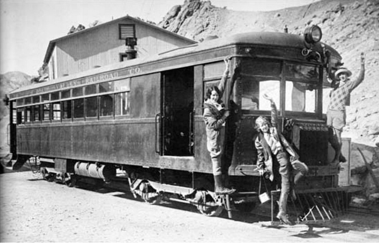 Death Valley Railroad motor car No. 5 was used to carry 1920s tourists like these three women to Death Valley