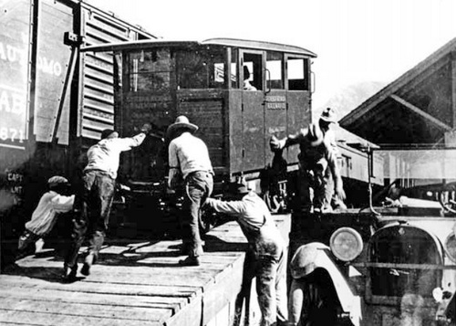 Eureka-Nevada car No. 22 being unloaded at the Southern Pacific station in Palisade, June 1927. (Photo acquired by Dale Darney from the son of Charles Sexton)