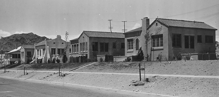 Newly built Mission Revival style houses for federal government employees and their families on Park Street, Boulder City, about 1932. Later, lawns were planted, and all the landscape and home maintenance was thereafter provided to the residents by government workers.