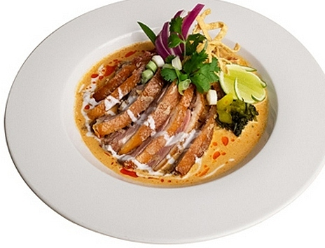 Khao Soi, crispy duck in a special curry sauce, is among the many exquisite Northern Thai dishes at Lotus of Siam.