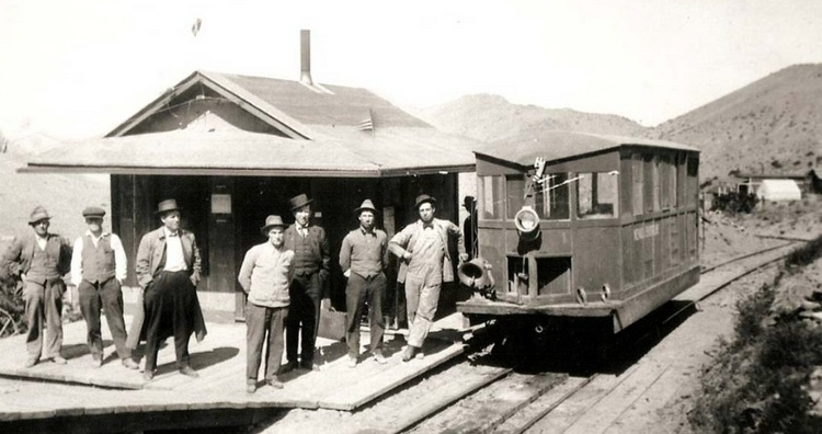 Nevada Short Line's motor car at Upper Rochester, fall of 1915. Third from left is Arthur A. Codd, NSL President and a Regent of the University of Nevada.