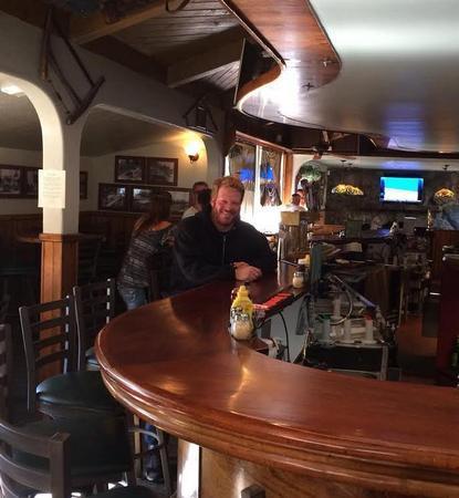 Happy customer at Wally's Huddle Grill & Bar