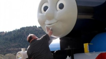 Like the countless children who adore him, Thomas needs to have his face washed from time to time.