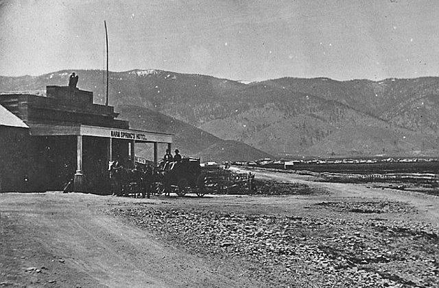 "The Warm Springs Hotel, with Carson City and the Carson Range in the distance. The Hotel's bar was ""a favorite watering hole of the guards"" at the nearby State Prison."
