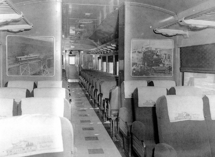 In this Western Pacific Zephyrette interior photo note the reclining seats, intended for long-distance passengers, in front of the partition. In the rear portion of the car are commuter-style reversible seats of the type usually found in Budd Rail Diesel Cars. The photo-mural on the left-hand partition shows a Zephyrette on the high bridge near Altamont Pass, California. The two Zephyrettes ran between Oakland and Salt Lake City three times a week for eleven years between 1950 and 1960.