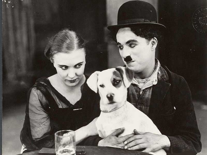 "Edna Purviance's first screen appearance and Charlie Chaplin in ""The Adventurers"" (1916)"