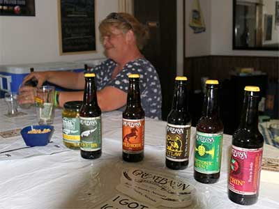 Jen at the whispering Elms putting out beers for the beer tasting at Snake Valley Days