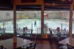 Brooksys Bar & Grill, overlooks a Hockey Rink