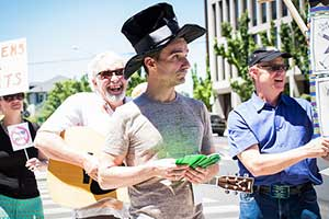 P.L.A.N. Cantastoria protesters in Reno CRA and allied organizations rallied to call attention to human rights violations by CMI Director Daniel Kappes in Guatemala.