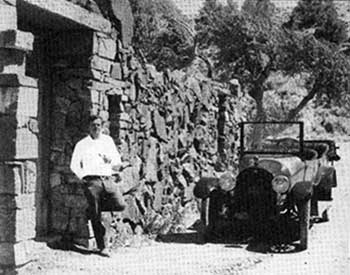 Carl Haas at the entrance to his 1000-year stone house