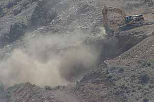 Comstock Mining Inc is hard at work putting toxic dust into our air