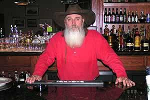 Gary Fly tending bar in Austin Nevada