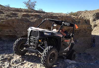 Gage Smith riding his RZR pedal to the metal