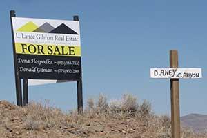 Lance Gilman Real Estate sign selling CMI property west of Dayton