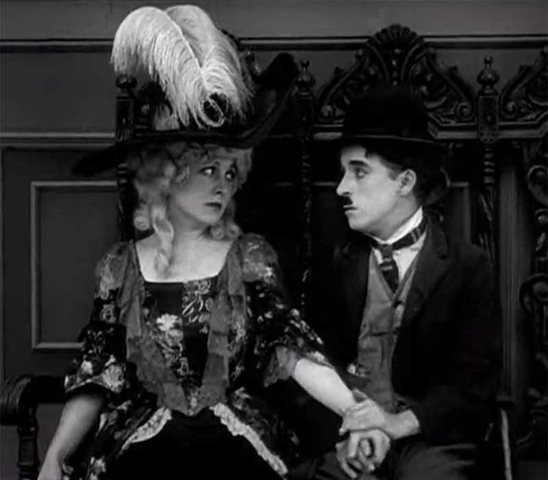 "Edna Purviance and Charlie Chaplin in ""The Idle Class"", 1915"