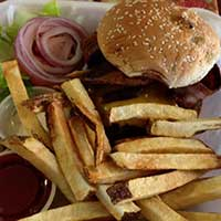 Bacon cheeseburger with fries International Cafe, Austin Nevada