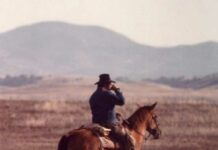 Joe Brown on horseback.
