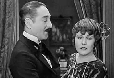 "Adolph Menjou and Edna Purviance in ""A Woman of Paris"""