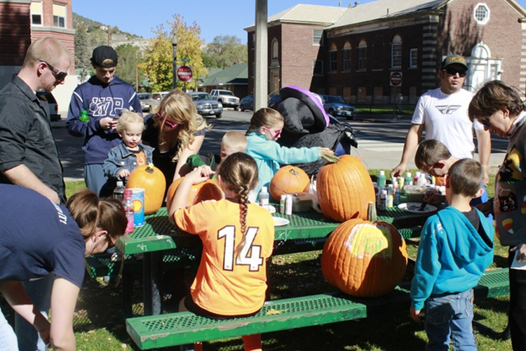 Kids paint pumpkins as part of the fun