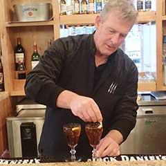 Joe Hughes mixes a Picon Punch at the Martin Hotel, Carson City Nevada