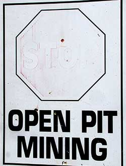 Faded poster: Stop Open Pit Mining