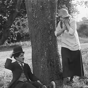 "Charlie Chaplin and Edna Purviance in ""The Tramp"""